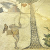 famous ancient byzantine mosaic of a trained monkey collecting dates from a date palm using a pole.  the monkey carries a cage with a falcon on it.