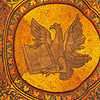 Magnificent golden mosaic of an eagle with bible, symbolising the evangelist John from the basilica of St Mark, Venice, Italy