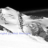 Monochrome of the ice covered summit of Castor in the southern swiss alps above Zermatt