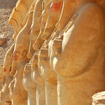 Line of statues of Queen Hatshepsut at Thebes in Egypt facing east