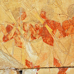 Two egyptian soldiers carrying bows in the early new kingdom mortuary temple of Queen Hatshepsut at Thebes in Egypt