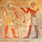 Pharaoh making offerings to the god Horus from the early new kingdom mortuary temple of Queen Hatshepsut at Thebes in Egypt