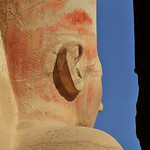 Statue of Queen Hatshepsut looking east at Thebes in Egypt