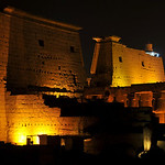 Illuminations of the entrance to the ancient egyptian temple of Luxor showing the first pylon.