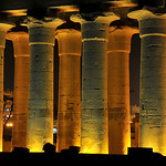 Illuminations of the the hypostyle hall at night of the ancient egyptian temple of Luxor in the town centre
