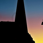 Silhouette at sunset  of Obelisk and statue of Ramses at the entrance of the ancient Luxor Temple in Egypt
