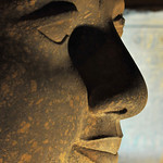 Profile of the giant head of Ramses II at night at the ancient Luxor Temple in Egypt