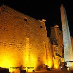 entrance of the Luxor Temple at night in Egypt with the first pylon and obelisk