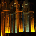 The great hypostyle hall in the ancient egyptian temple of luxor in the town centre illuminated at night
