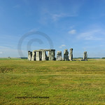 The entire circle of standing stones at Stonehenge in England, with Salisbury plain in the background at the summer solstice