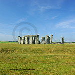 The entire circle of stones at Stonehenge in England at the summer solstice. In the background, Salisbury Plain