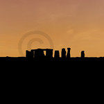 Red sky over the silhouette of the entire circle of standing stones at Stonehenge in England